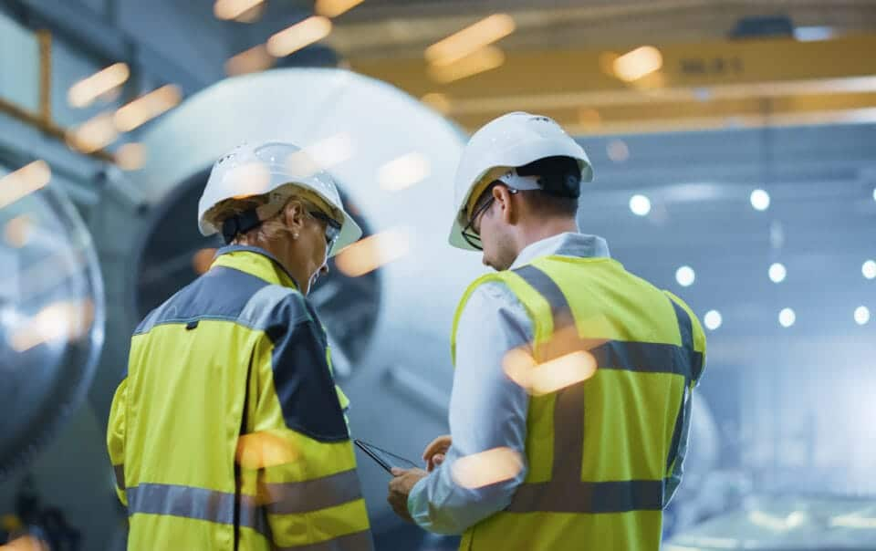 Manufacturing workers looking at plans